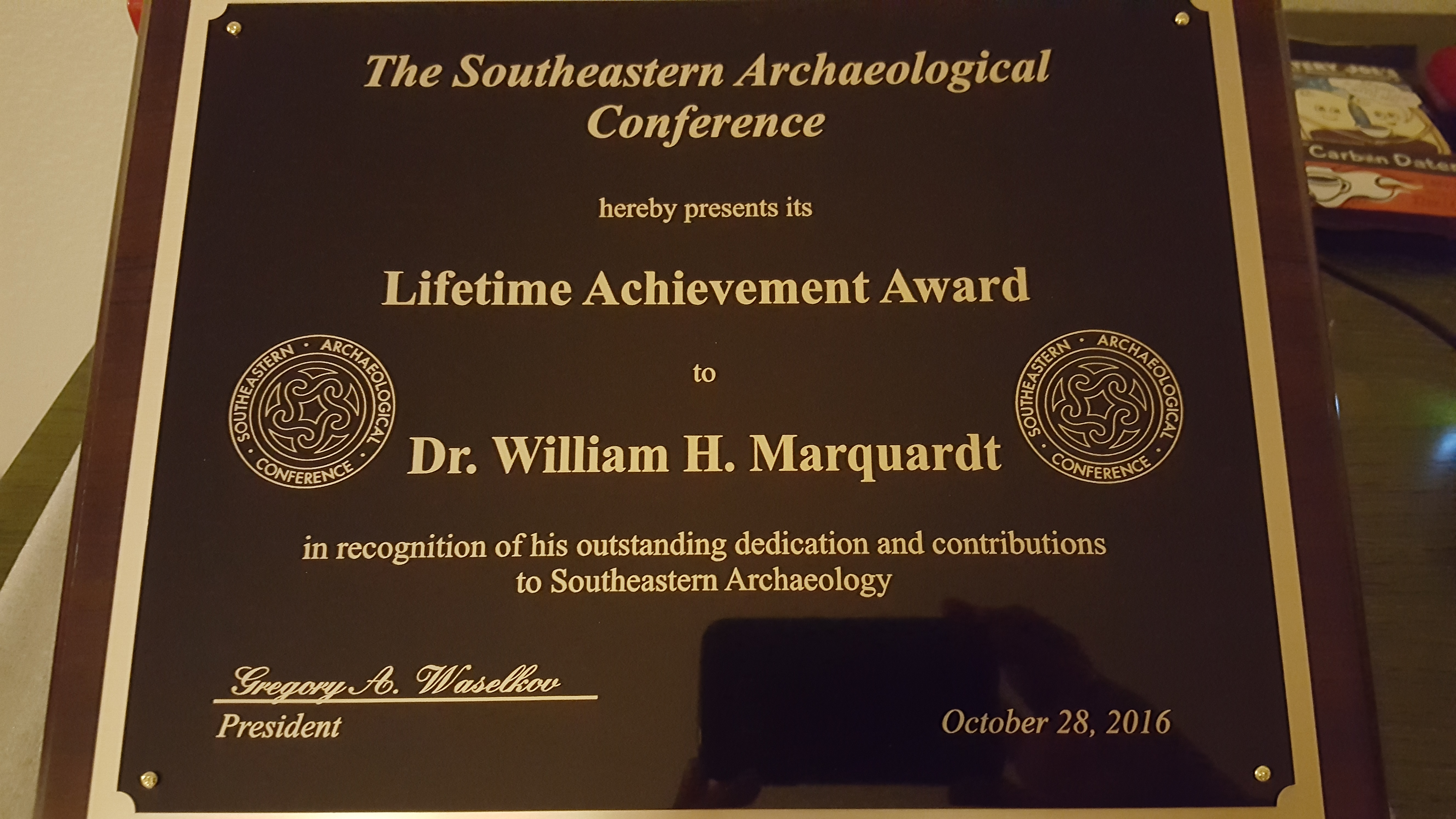 Photo of diploma plaque given to Dr. William H. Marquardt.