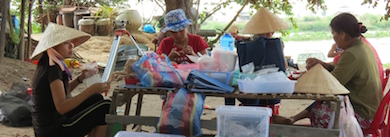 Michelle Eusebio 2014 - in floral hat - on site sorting of dried sorted finds in Lo Gach site, Vietnam photo by Quy Tran