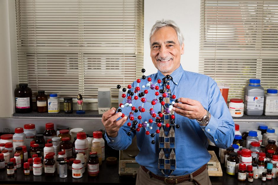George Christou holds model of molecule