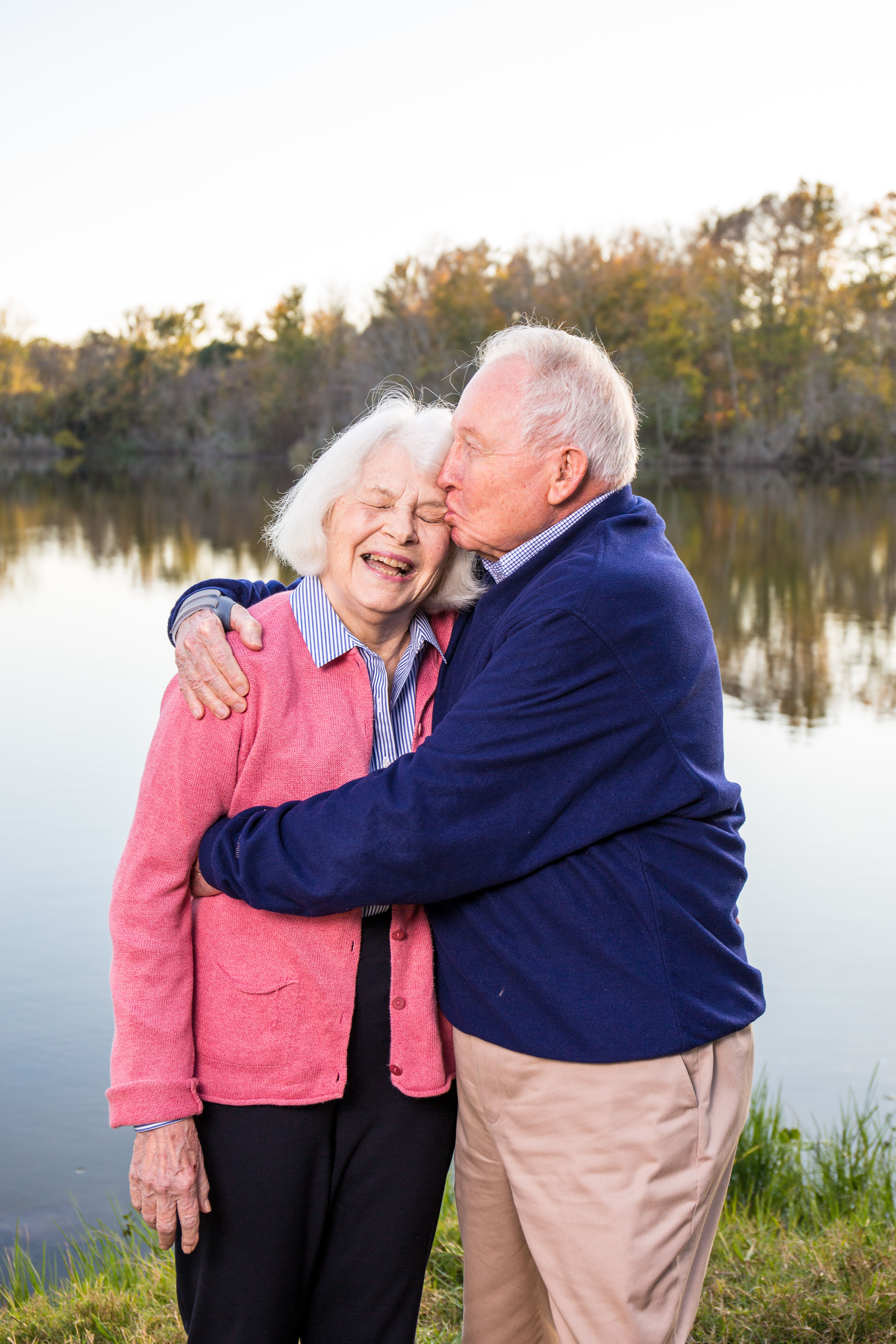 Photo of the Wiltshire at Lake Alice. Jim is hugging Susan and kissing her forehead.