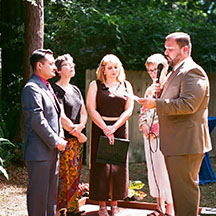 Antonio-Sajid Lopez (right) marries Carlos Roberto Ayerdi (left), in a ceremony officiated by UF SPS alumn Christina Stokes (center), and witnessed by SPS faculty member Kathy Navajas and Aleisa Zoecklein.
