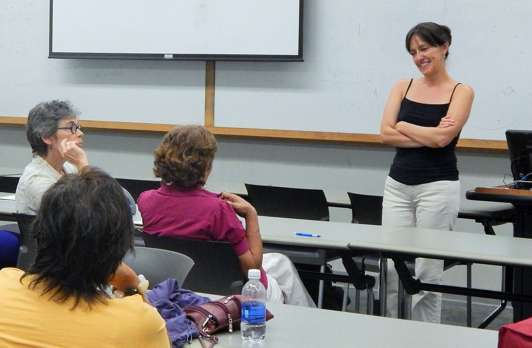 Tania Hermida speaking with attendees.