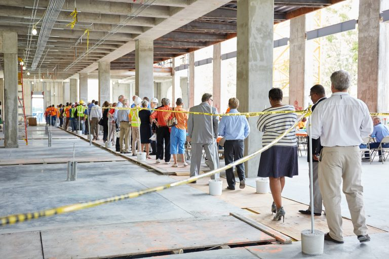 line of people entering the beam-signing ceremony