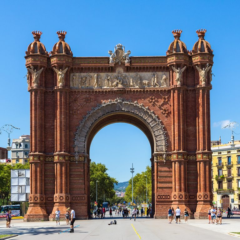 Spanish archway with blue sky and plaza beyond