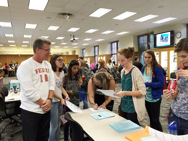 Dr. Moreland speaks with stuents at the SPS Major Event ( fall 2015)