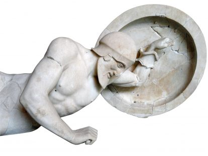 photograph of sculpture of fallen Grecian soldier holding shield
