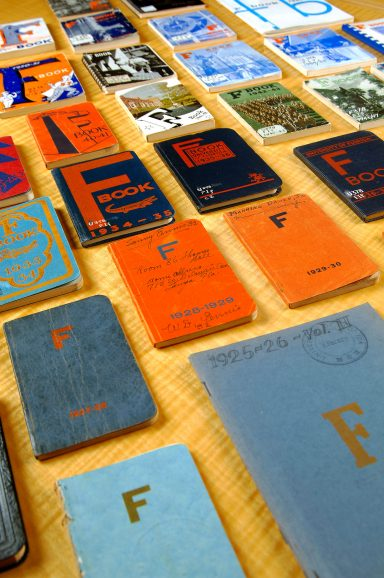 colorful small books spread out over table