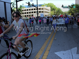 Image of a person riding a bike with the caption, Moving right Along